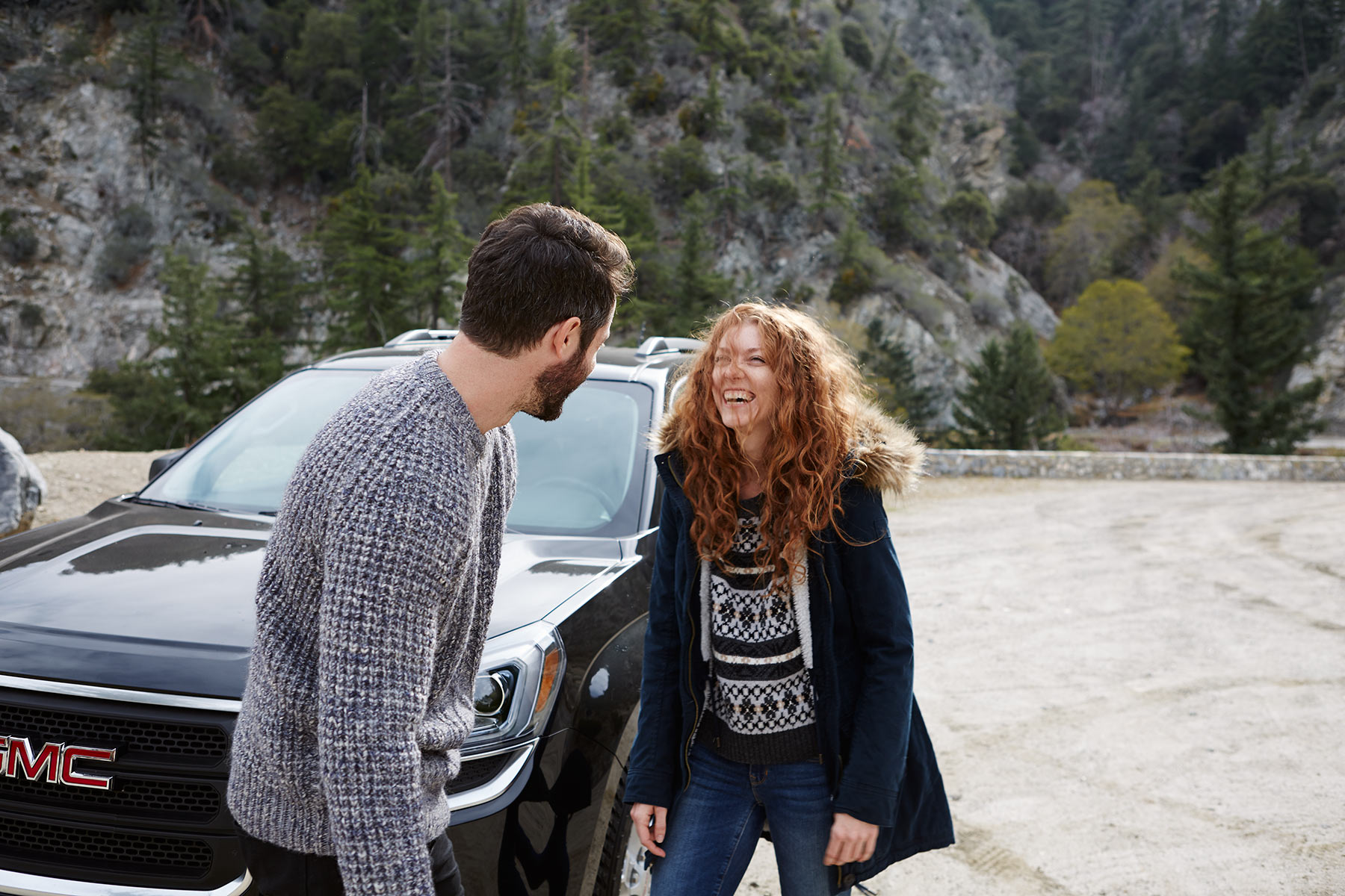 Lifestyle_Car_Auto_Advertising_Chicago_Los_Angeles_Young_Couple_Mountains_SUV_Laughing_Fun_Hooded_Jacket_Fur_Sweater_Beard_Read_Hair_Mike_Henry_Photography