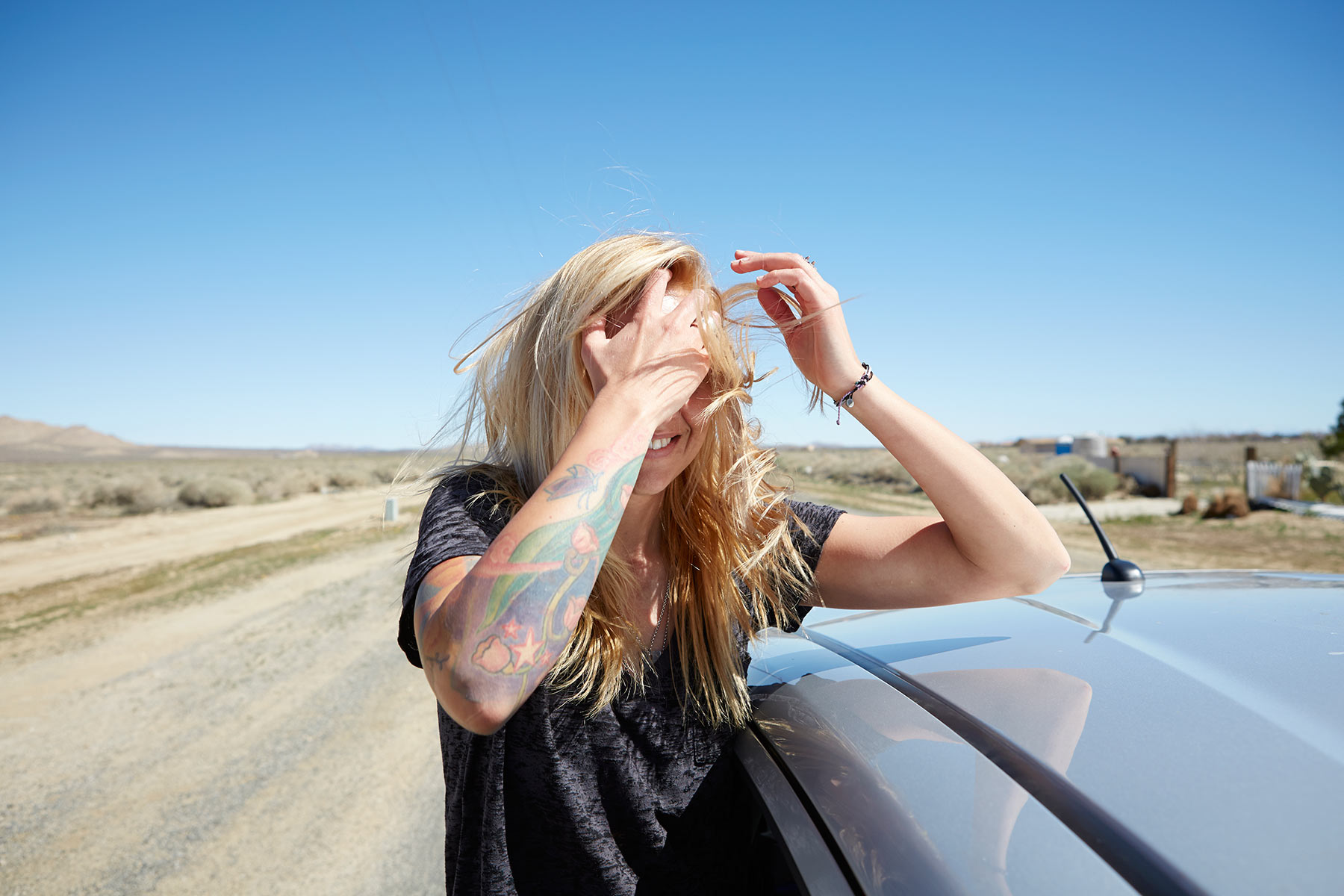 Desert_Lifestyle_Advertising_Photographer_LA_Los_Angeles_Chicago_Advertising_Commercial_Photographer_Woman_Girl_Youth_Culther_Out_Car_Window_Wind_in_Hair_Fun_Blowing_Mike_Henry